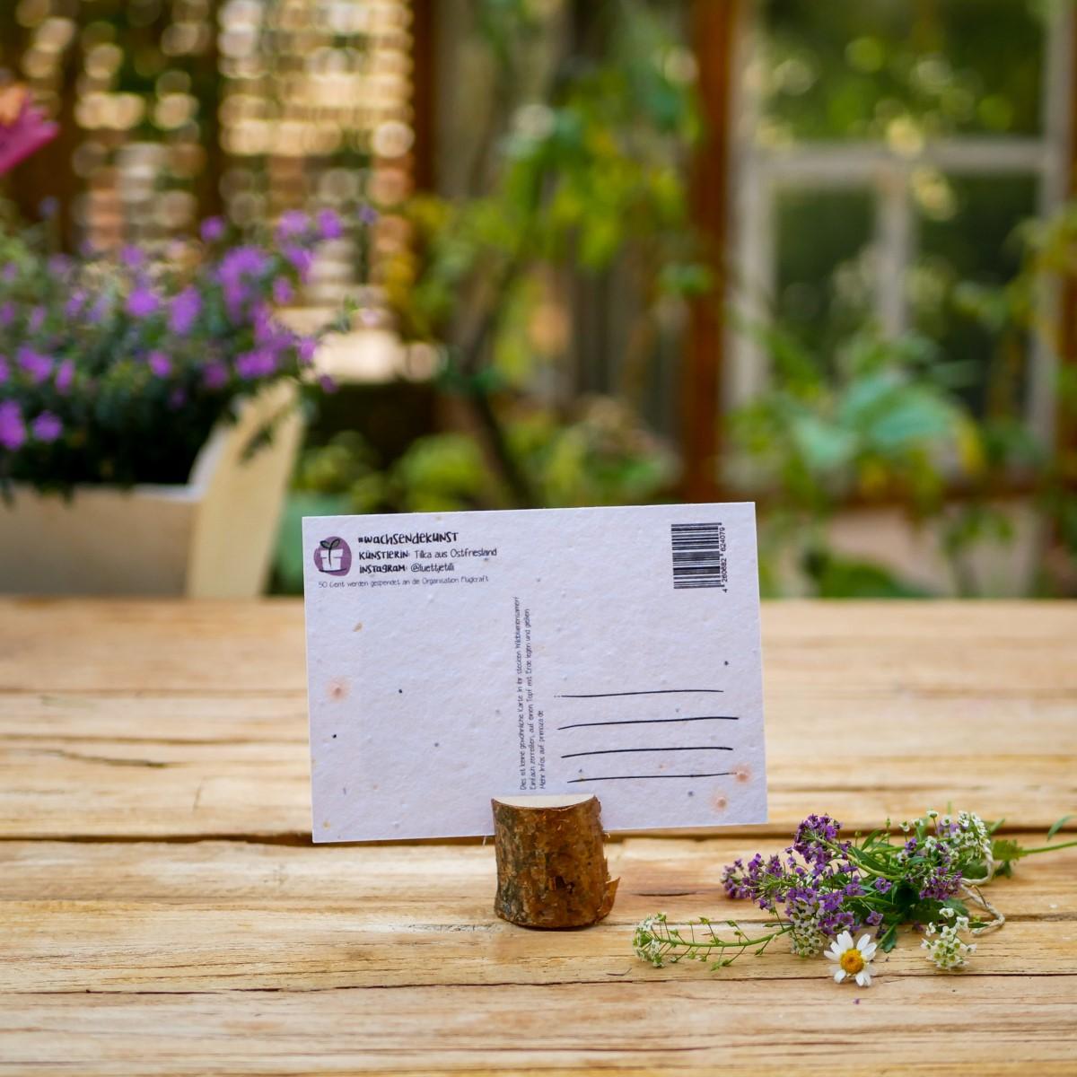 Einpflanzbare Postkarte aus Samenpapier mit Motiv eines Briefumschlages und Lavendel