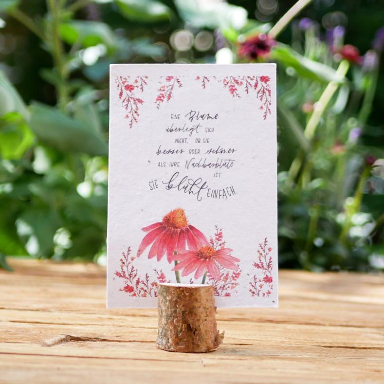 Einpflanzbare Postkarte aus Samenpapier. Grußkarte mit handgezeichnetem Blumenmotiv. Karte für den guten Zweck