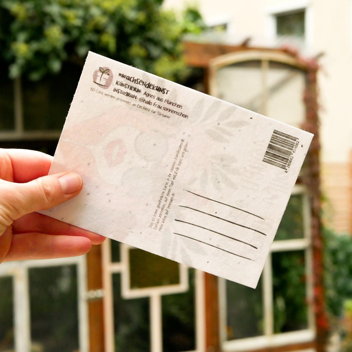 Rückseite der einpflanzbaren Postkarte aus Samenpapier mit Frau mit Sonnenbrille und Blumenkranz als Motiv.