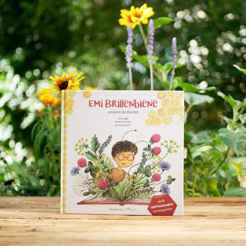 """Cover des nachhaltigen und interaktiven Kinderbuchs """"Emi Brillenbiene"""". Mit Samenpapier Karten für bienenfreundliche Blumen zum Einpflanzen"""