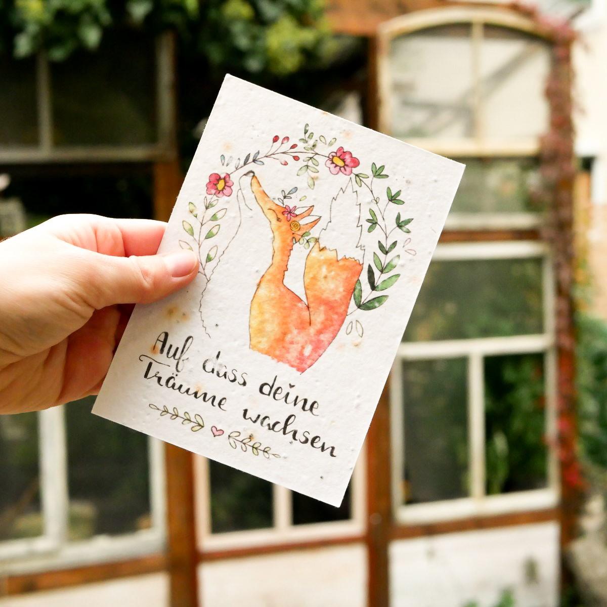 Einpflanzbare Postkarte aus Samenpapier. Geburtstagskarte mit handgezeichnetem Motiv mit Fuchs und Blumen.